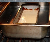 Flan in water bath in oven