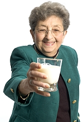 Senior woman with glass of milk