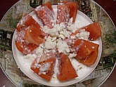 Goat cheese dressing over tomato