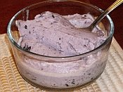 Bowl of homemade goat milk blueberry ice cream