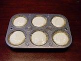Unbaked quark tarts in muffin pan